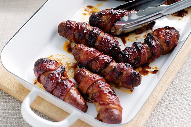 Sticky bacon-wrapped sausages