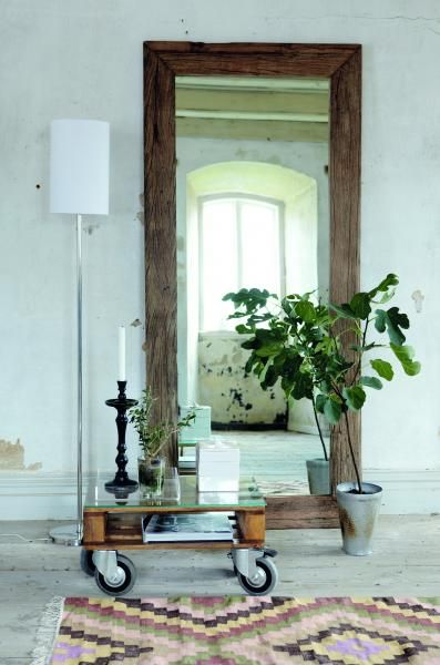 Love this mirror. Looks like its made of old wood. From: http://www.anno.as/products/bn0301-toft-stort-speil-drivved