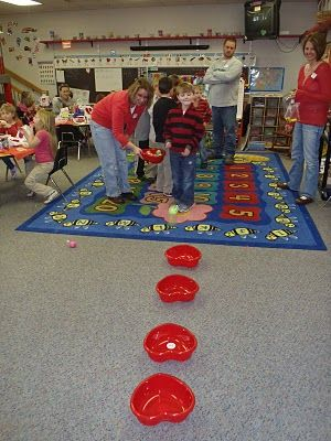 Heart ball toss game, add numbers for a math twist and this might be fun like the grand prize game!!!!