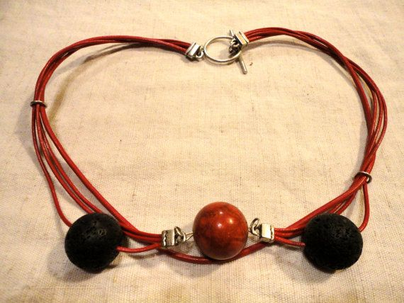 Handmade coral lava stone and red leather necklace by JolaCrafts  price: EUR 35.00.  Click here to see more.   // handmade jewelry // handmade jewellery // coral jewelry // coral jewellery // lava rock jewelry // lava rock jewellery