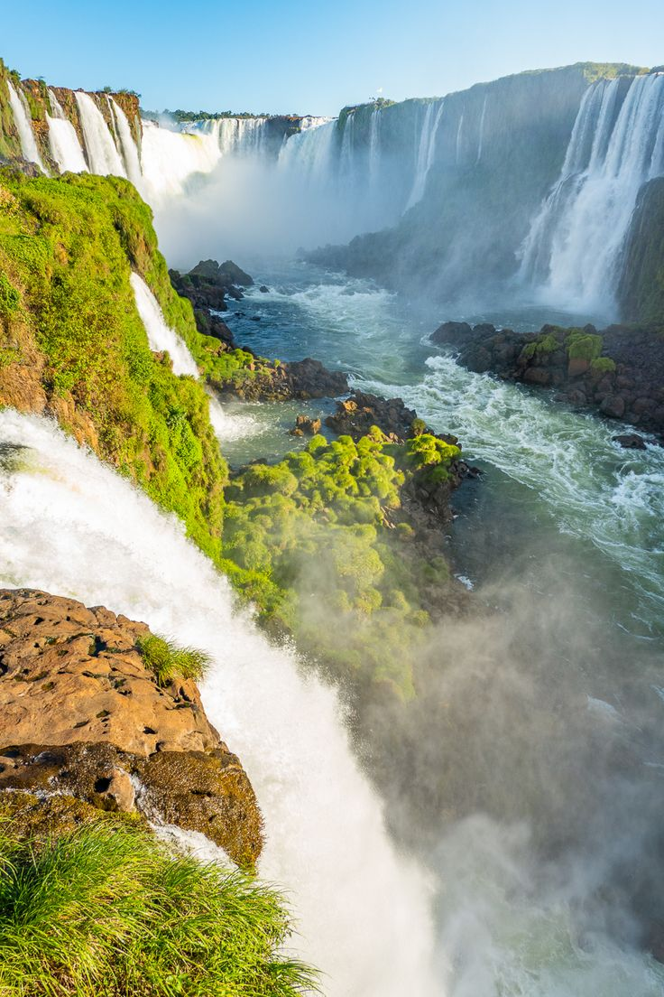 Looking for the best things to do while visiting Brazil or Argentina? Iguazu Falls is a must see. The Iguazu Falls are the largest waterfall in the world! Beautiful Waterfalls, Beautiful Landscapes, Places To Travel, Places To Visit, Visit Brazil, Largest Waterfall, Argentina Travel, Nature Illustration, South America Travel