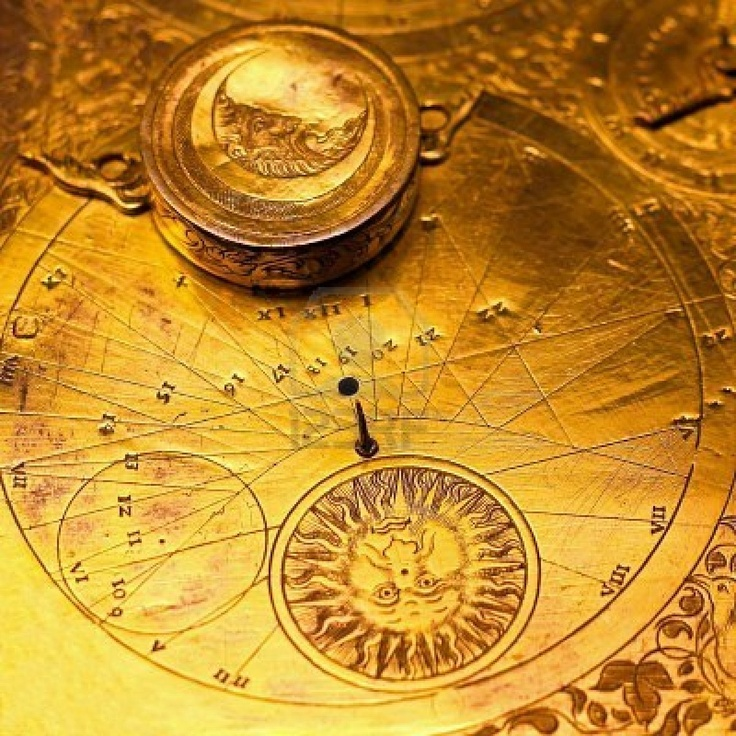 Golden clock dial with sun and moon