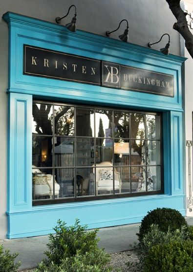 Vintage industrial lighting   glossy black & turquoise paint   french paned window   gray stucco = yes, please.