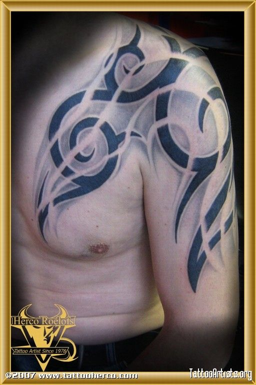 Arm and chest tattoo