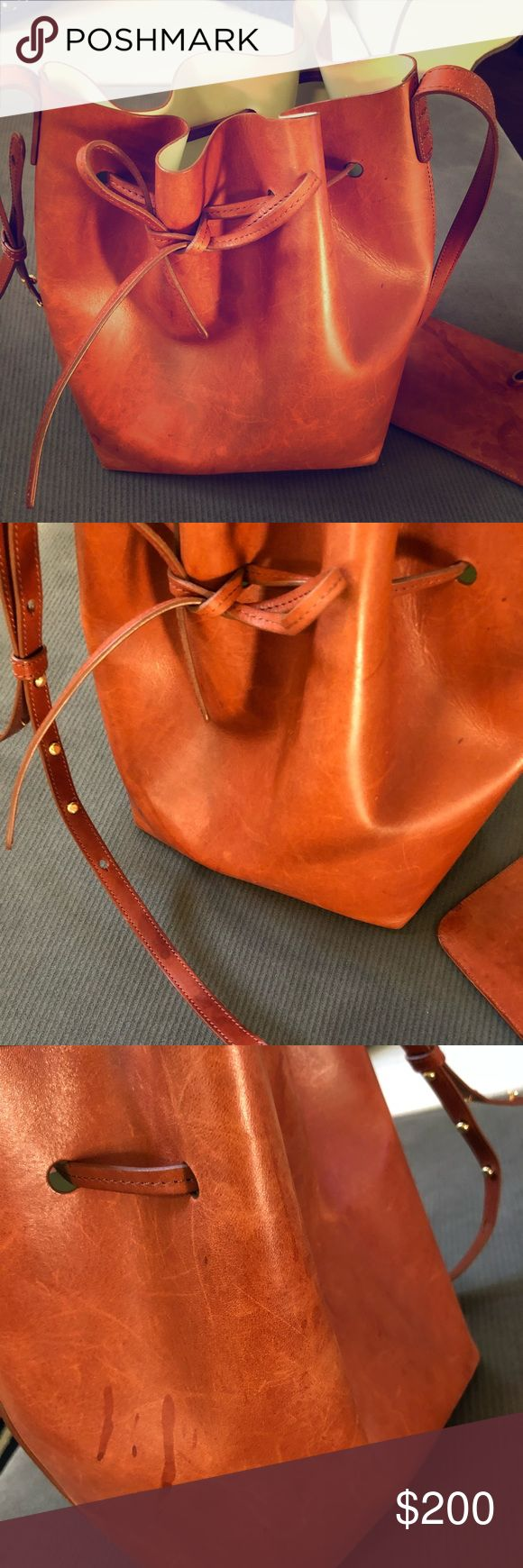 Authentic Mansur Gavriel Large Bucket Bag Large Mansur Gavriel Bucket Bag. Has water damage as can be seen from pictures. Inside is in good condition- front of bag is in good condition. Color is: Brandy/Cleo Mansur Gavriel Bags Shoulder Bags