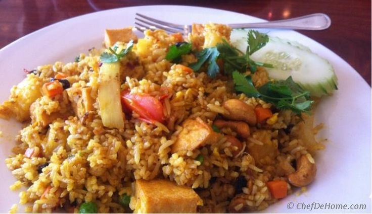 I always keep finding ways to flavor rice. Curry and rice is one of my all time favorite. Aromatic curry and few basic spices gives wonderful flavor to fried rice. I have used pineapple and raisins...