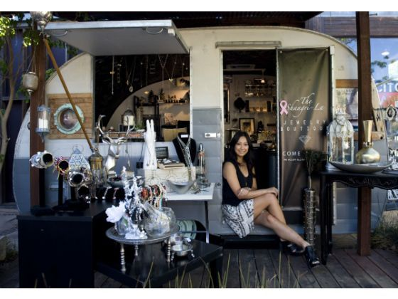 Karen Hsiang, owner of the Shangri-La vintage jewelry store, sits inside the Airstream-like trailer she rents at The LAB in Costa Mesa.