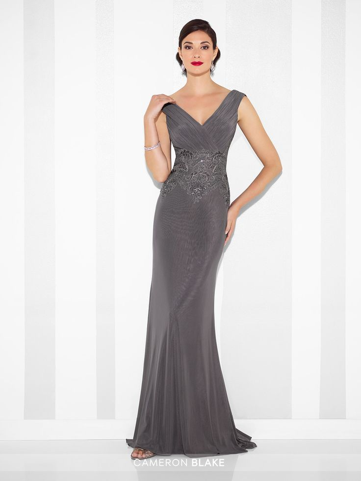 Cameron Blake - 117611 - Tip-of-the-shoulder elastic netting fit and flare gown with ruched cap sleeves, V-neckline, crisscross ruched bodice with lace motif midriff, draped cowl back finished with matching motif, inset sweep train. Matched shawl included.Sizes: 4 – 20Colors: Jade, Charcoal, Blush