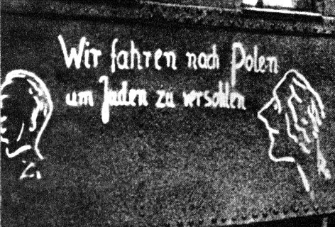 """The side of a troop train headed to Poland bears caricatures of Jews and the message, """"We are going to Poland to thrash the Jews."""""""
