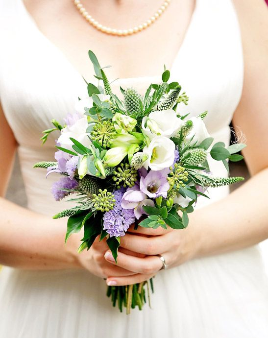 Florissimo, Shropshire - Flowers for weddings, events, businesses and homes. Naturalistic and organically-styled white hand-tied bridal bouquet of gorgeously-scented freesia, lisianthus, veronica, alstroemeria, statice, trachelium, eryngium thistle and berried ivy.