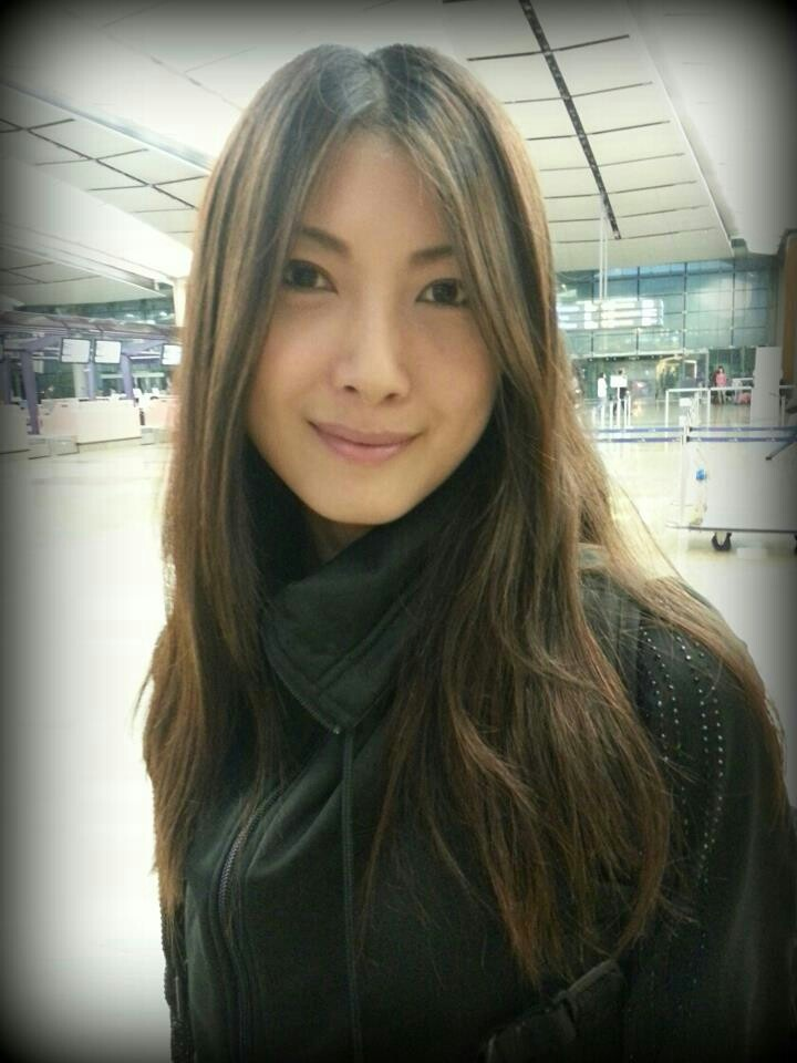 Jeanette Aw going on holidays. Sweet smile on her face.