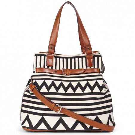 Woven tribal print bag with dome shaped feet, faux leather trim and removable cross body strap. $59.95