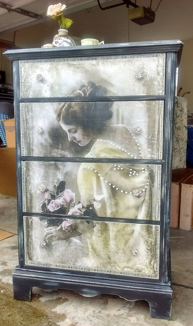 Antique dresser painted in several layers to create age.  A vintage print was decoupaged on the drawer fronts.