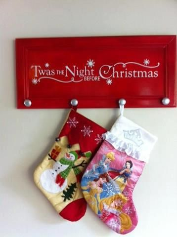 Stocking holder made of a re-purposed cupboard door :) Especially helpful for those w/o a mantle!