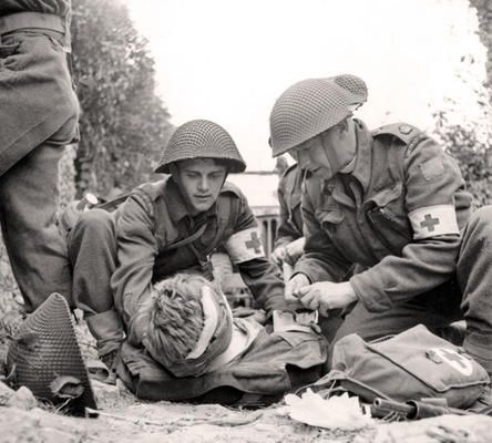Medics help a Canadian Soldier with a head injury on July 15, 1944. It is credible because the source provides us a date and was taken when it happened. What it tells us about changing lives of people at this time is that Canadians are getting injured and that the war overseas is very dangerous.