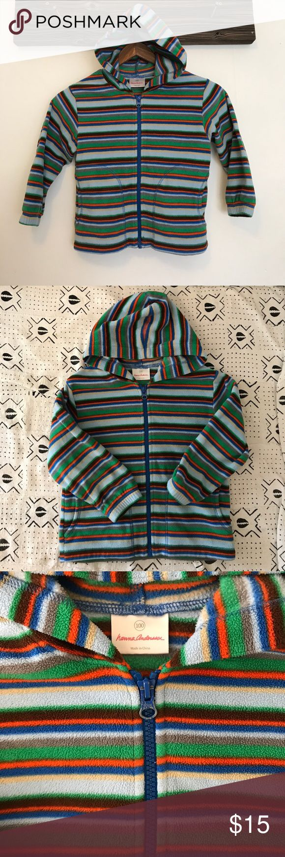 Hanna Anderson fleece striped zip up hoodie My son lived in this hoodie since it's super soft and cozy, it's way to wash and has pockets. There's no stains or rips, it's in great condition with lots of life left. It's sized at a Hanna Anderson 100. Hanna Andersson Shirts & Tops Sweatshirts & Hoodies