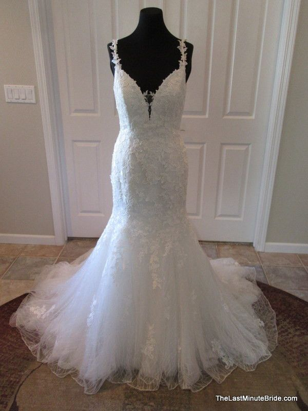 Description Jasmine F171005 Venise lace over tulle fit and flare wedding dress with a plunging sweetheart neckline, delicate lace straps in the front finish a low scoop back. The back of the dress fea