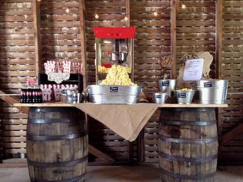 Having an outdoor wedding? Consider offering a popcorn bar! Your guests will love the creativity and the late night snack at your rustic barn wedding! | The Homestead 1835