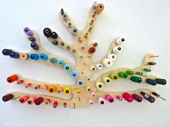 My biggest problem - keeping my small sewing area clean--the thread!   Here is the list of 8 inspiring thread holders.        This one is...