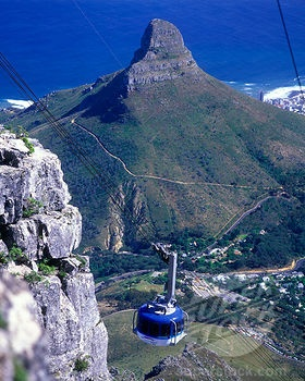 Cape town, cable car - to and from Table Mountain. We booked on line tickets at our hotel, which saved us some time at the venue. If you can do this we would suggest you do. We still had a long queue over 1 hour and it was a little bit chaotic, but well worth it. The views are just wonderful, we spent about 1 hour on the mountain. Wear sun block. http://tablemountain.net/buy_tickets/