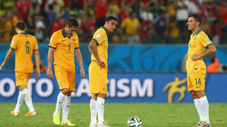Mark Milligan, Tim Cahill and James Troisi of Australia wait to kickoff
