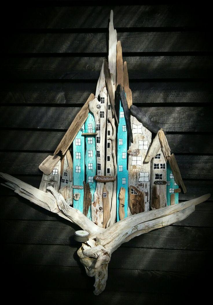 "Drivtømmer huse "" The eagel "" med levende Lys. Driftwood town/houses with candel ligth. Designed by EVA s."