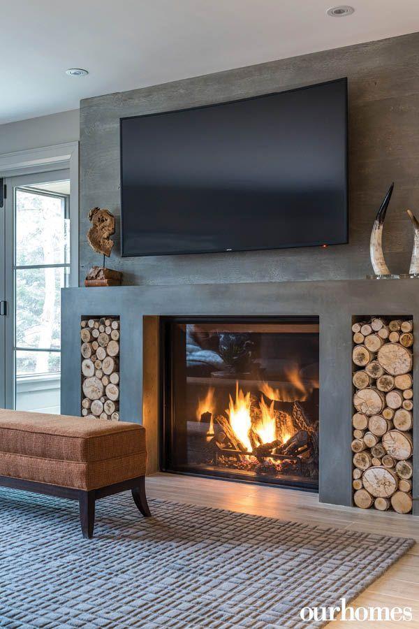 Der Moderne Gaskamin Aus Beton Befindet Sich Zwischen Den Türen Zum Living Room Decor Fireplace Gas Fireplace Ideas Living Rooms Contemporary Gas Fireplace