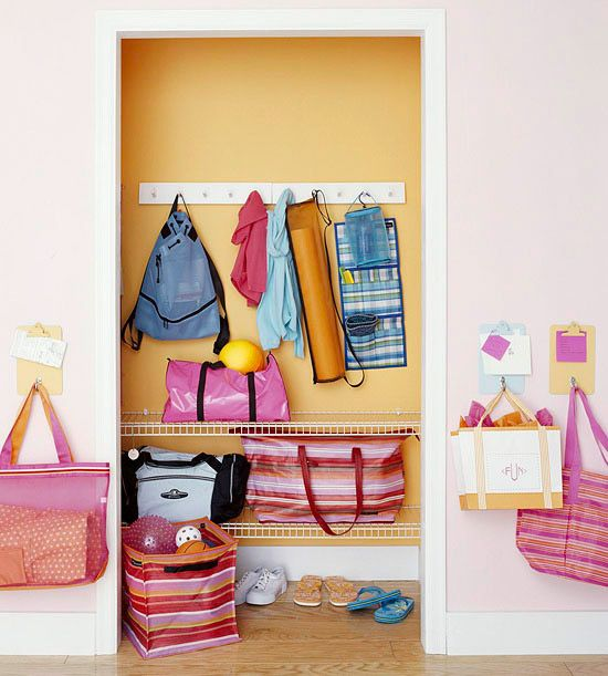 Thinking about hanging clipboards by the door like this, with hooks for keys and pouches for other stuff.