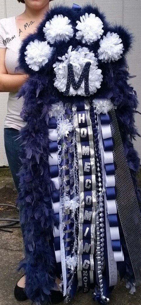 Mum A Mia is home to the original paw print homecoming mum. Let me create this unique design for you. Custom orders welcome.