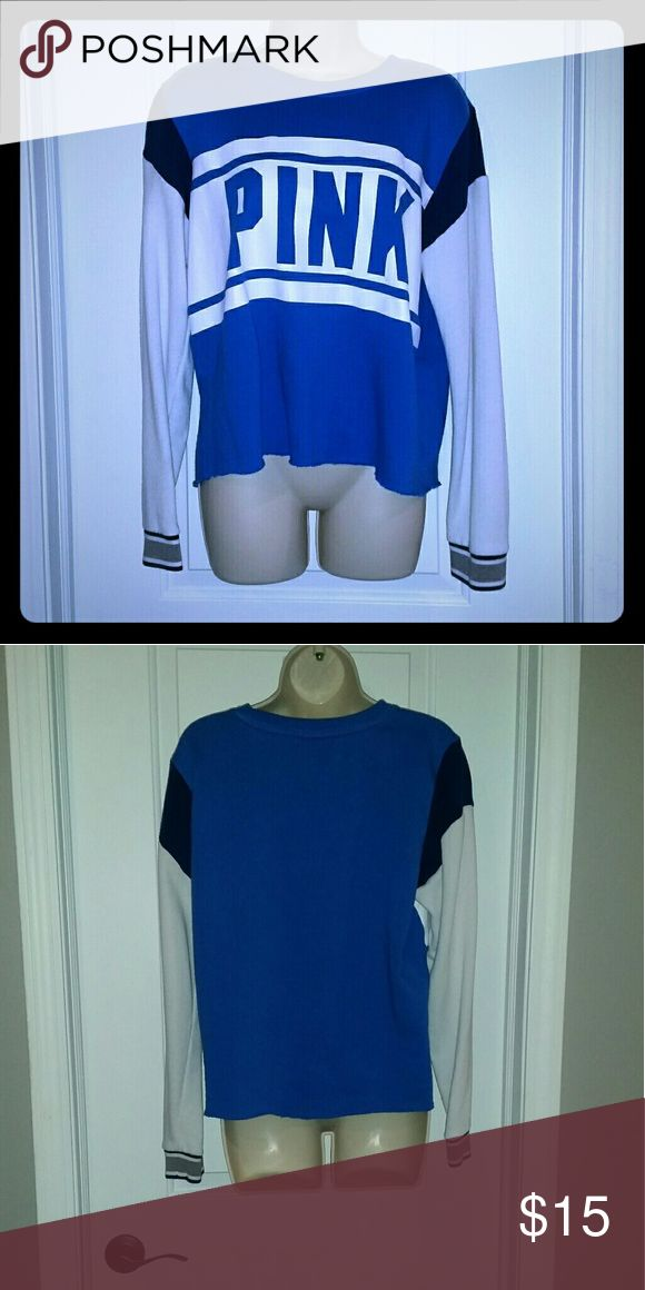 PINK Vintage Sweatshirt Blue and white sweatshirt. Pink brand by Victoria's secret. Slouchy, loose fit. Has no bottom hem, so the bottom kind of rolls up giving it that classic, vintage look. Size medium. Armpit to armpit 21 inches. Length 22.5 PINK Tops Sweatshirts & Hoodies