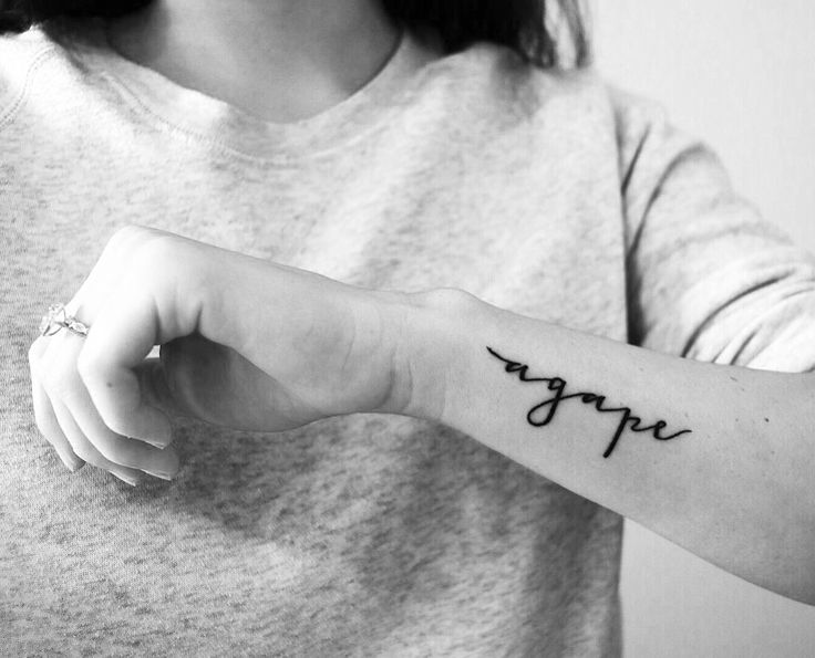 agape love tattoo. small and dainty.