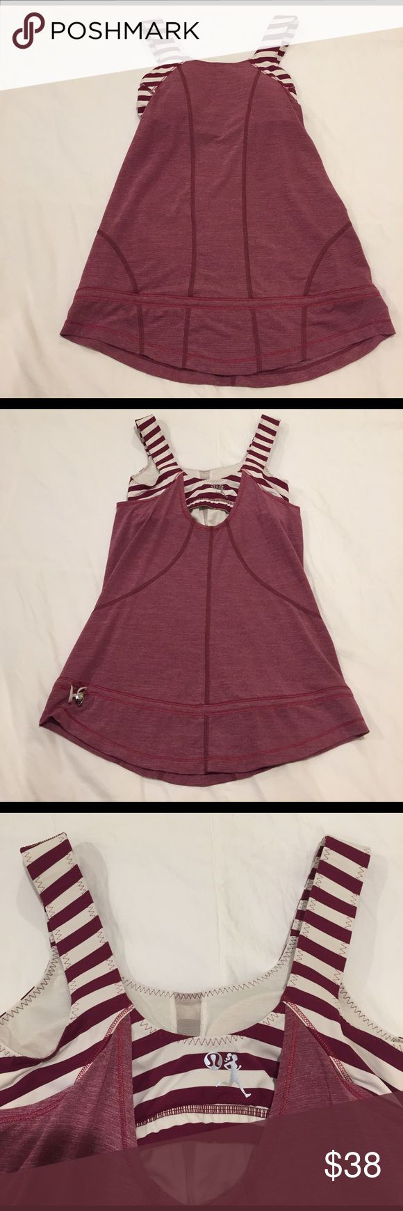 Own 100's of Lulu and not enough closet space! Lululemon workout tank in size 4. Featuring an adjustable drawstring at the waist. Wear it higher up at the waist, or leave it open down by the hip. Also featuring a shelf bra with removable cups included! Only wore a few times and in excellent condition! lululemon athletica Tops Tank Tops