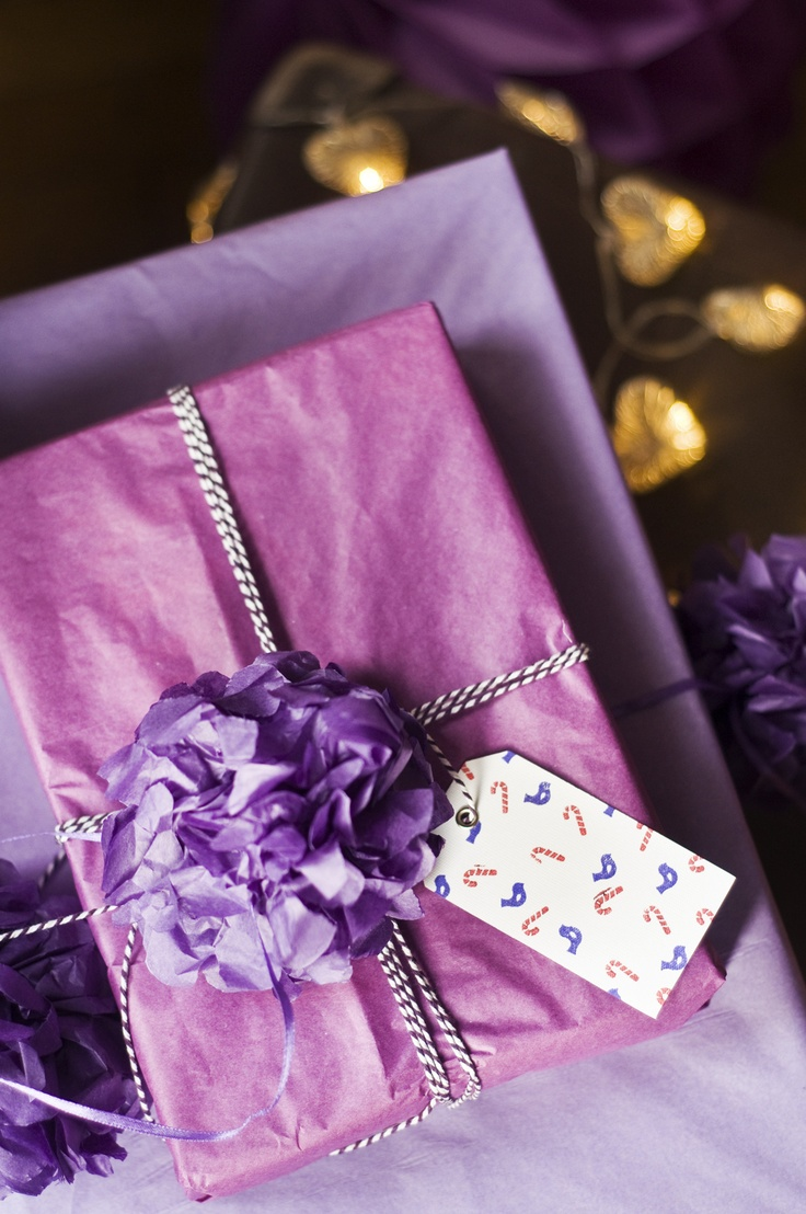 Gift wrapping: tissue paper, pompom, Baker's twine, label with stamp