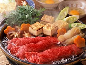 Sukiyaki and shabu-shabu are two different types of Japanese cuisine, both involving thin slices of beef that are boiled at your table.
