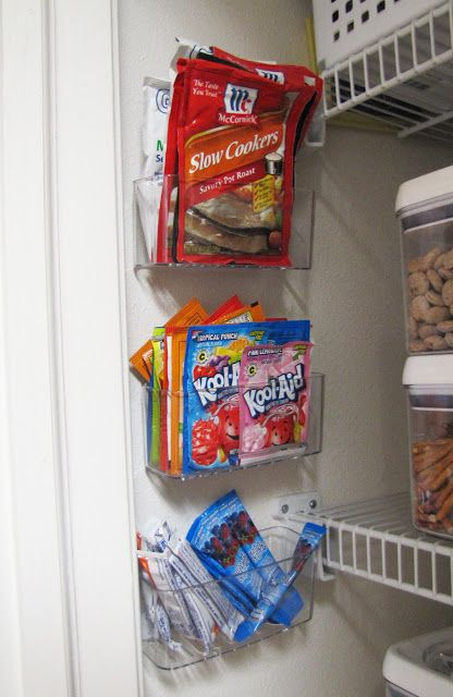 Shower caddies on the wall of the pantry to hold sauce and juice packets. Smart!