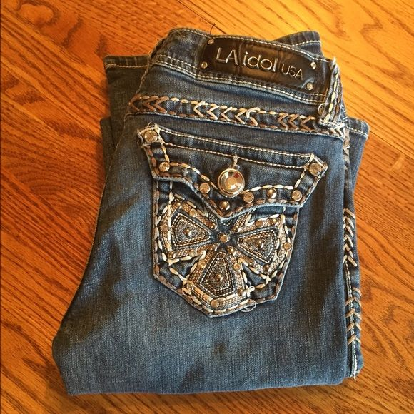 LA Idol Jeans Lightly used, but still in good shape! Boot cut, medium wash and bedazzled pockets :) LA Idol Jeans Boot Cut