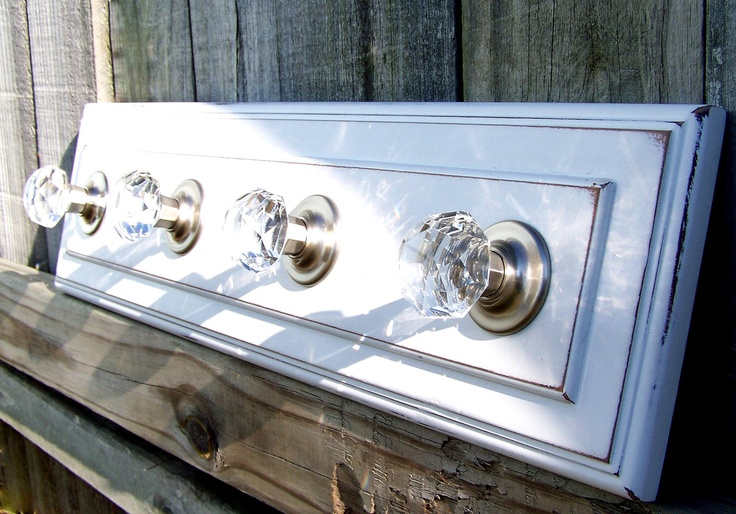 Have one like this I made in my entry hall.  Great for hanging guest's coats. Vintage coat hanger made with crystal door knobs - Google Search