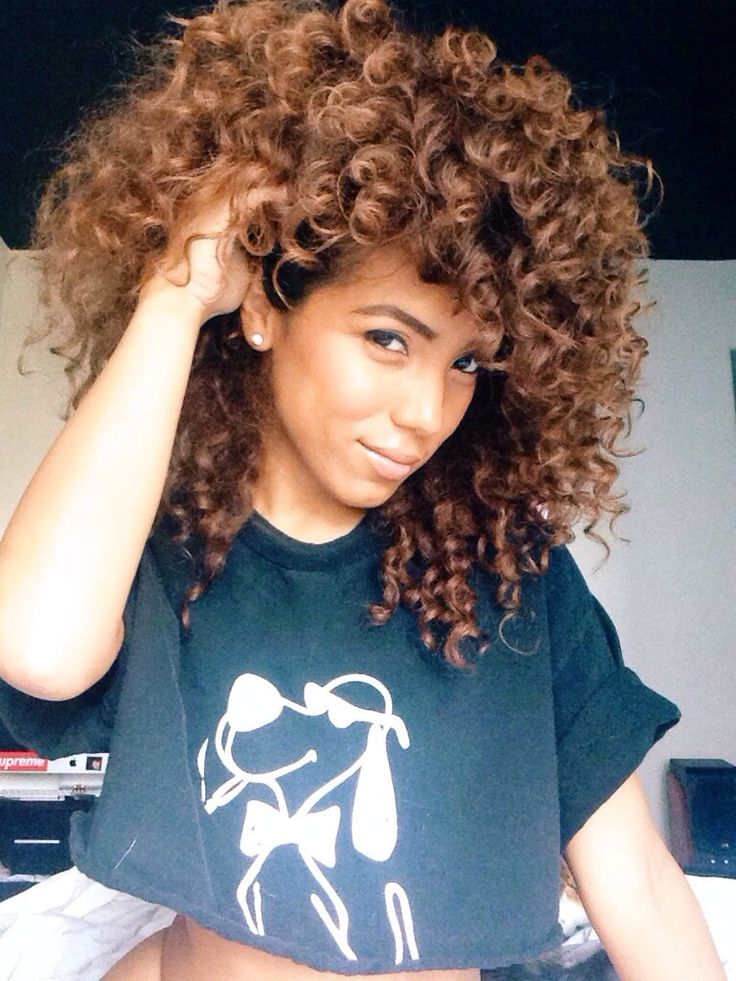 beautiful naturally curly hair. All that volume! >>> LOVING EVERYTHING THE CURLS AND THE COLOR, BELLA <<<