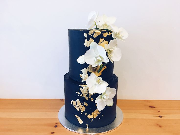 All black buttercream wedding cake with gold foil detail & white phal orchids #haranspatisserie
