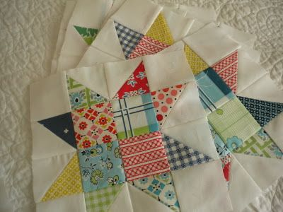 ★ 4 square centre and then the outer layer of squares contains alternating squares that are made from two triangles. Simple and effective.