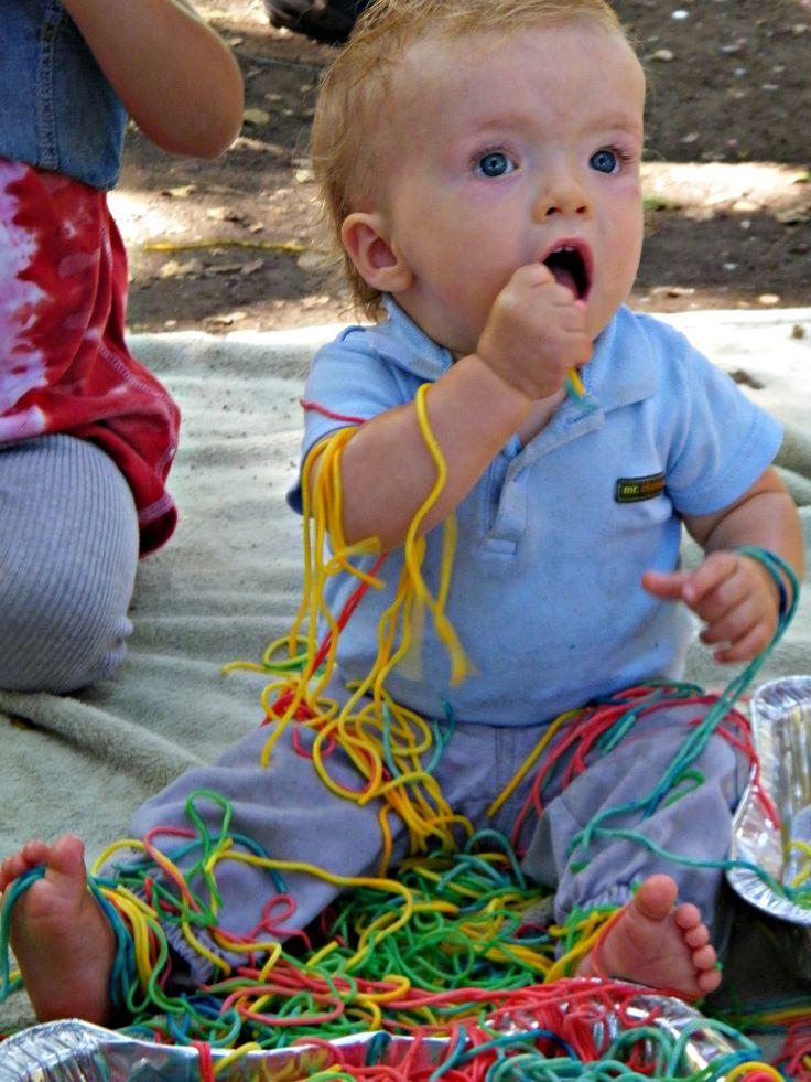 messy play with rainbow spaghetti
