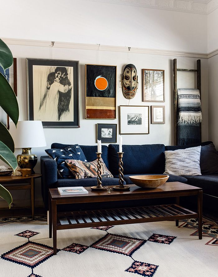 Southwestern rug + blue couch + gallery wall | 8X10 RUGS UNDER $500