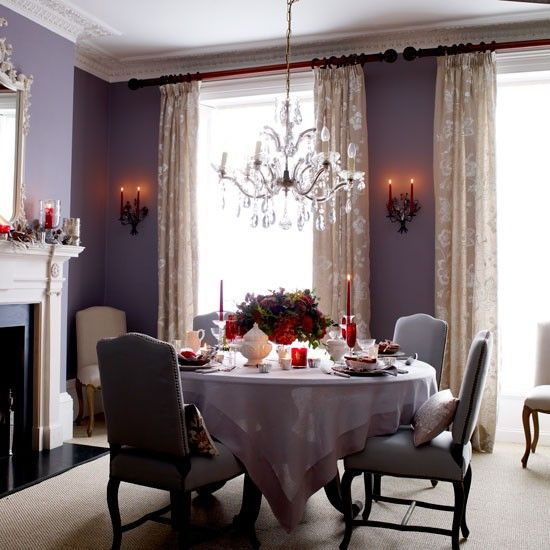 Christmas dining rooms / Create atmospheric lighting /   Pendant light fittings play a key role in creating an intimate lighting arrangement: a chandelier suspended three feet above the tabletop will throw light into the mid-range as well as downwards without distracting your guests' line of sight while they talk. Add candlelight and the light from an open fire for maximum magic.