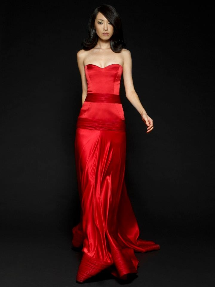 Eye-popping red strapless gown with satin detailing. Would be sure to steal the show in this ensemble.