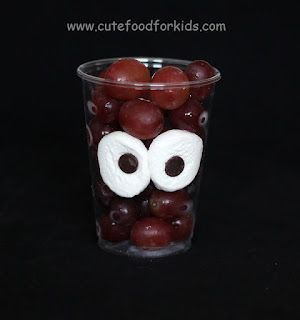 Cute Food For Kids: Halloween Snack Idea: Monster In My Cup! made with Marshmallow eyes, then you can add anything to the cup.. chocolate pudding, cheerios, grapes. What a cute idea for an easy snack!