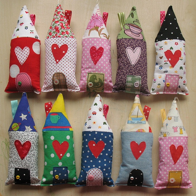 little houses could fill with sand for cute doorstops