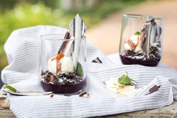 Red wine gel topped with a hazelnut crumble and white chocolate mousse balls
