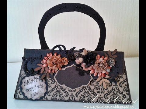 A Purse in black and brown colors