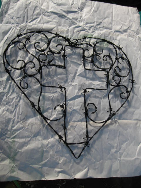 Barbed wire cross within a heart