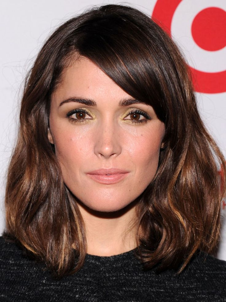 Side-swept bangs: No surprise that Rose Byrne, as an oval, is a bit of a bang chameleon. She's worn straight-across blunt ones in the past, but I also like her in this side-swept style—which works not just on ovals but every face type. Hairlines without cowlicks or widow's peaks have an easier time with these bangs, since the hair will be more cooperative at staying on one side.